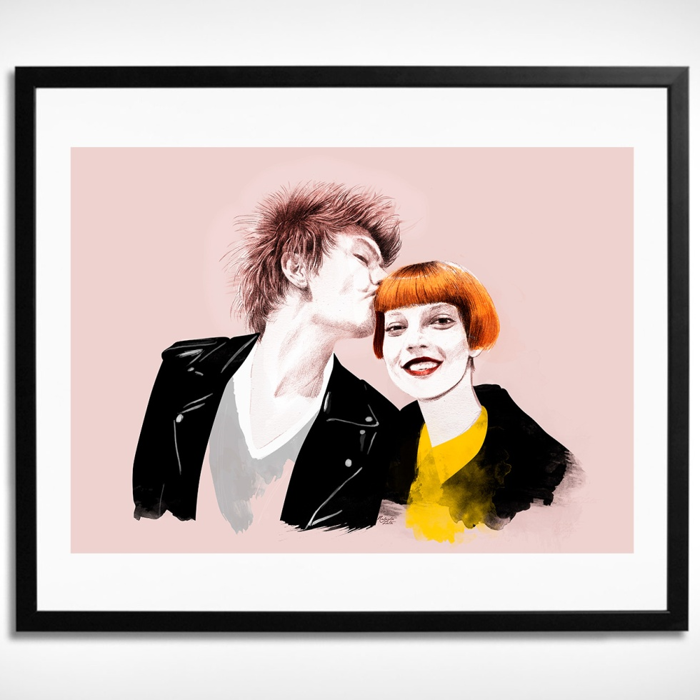 Framed portrait of a young couple kissing hanged on a wall