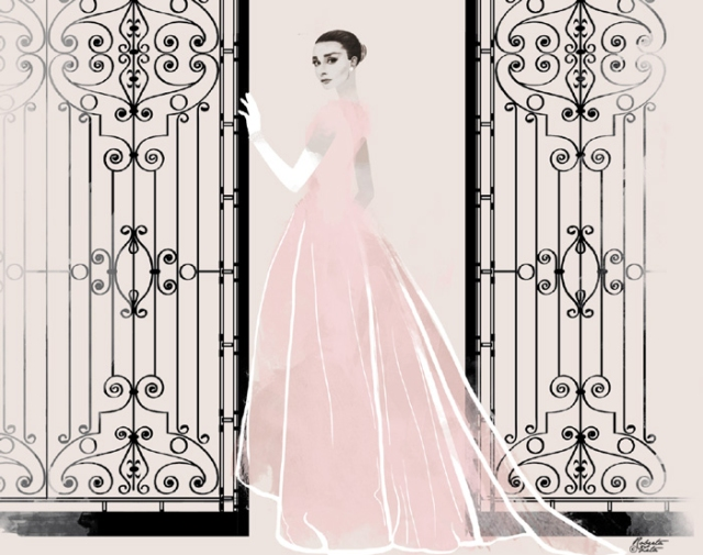 Audrey Hepburn standing close to a gate