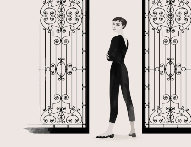 Portrait of Audrey Hepburn standing close to a gate